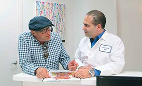 an image of an older man speaking with his doctor